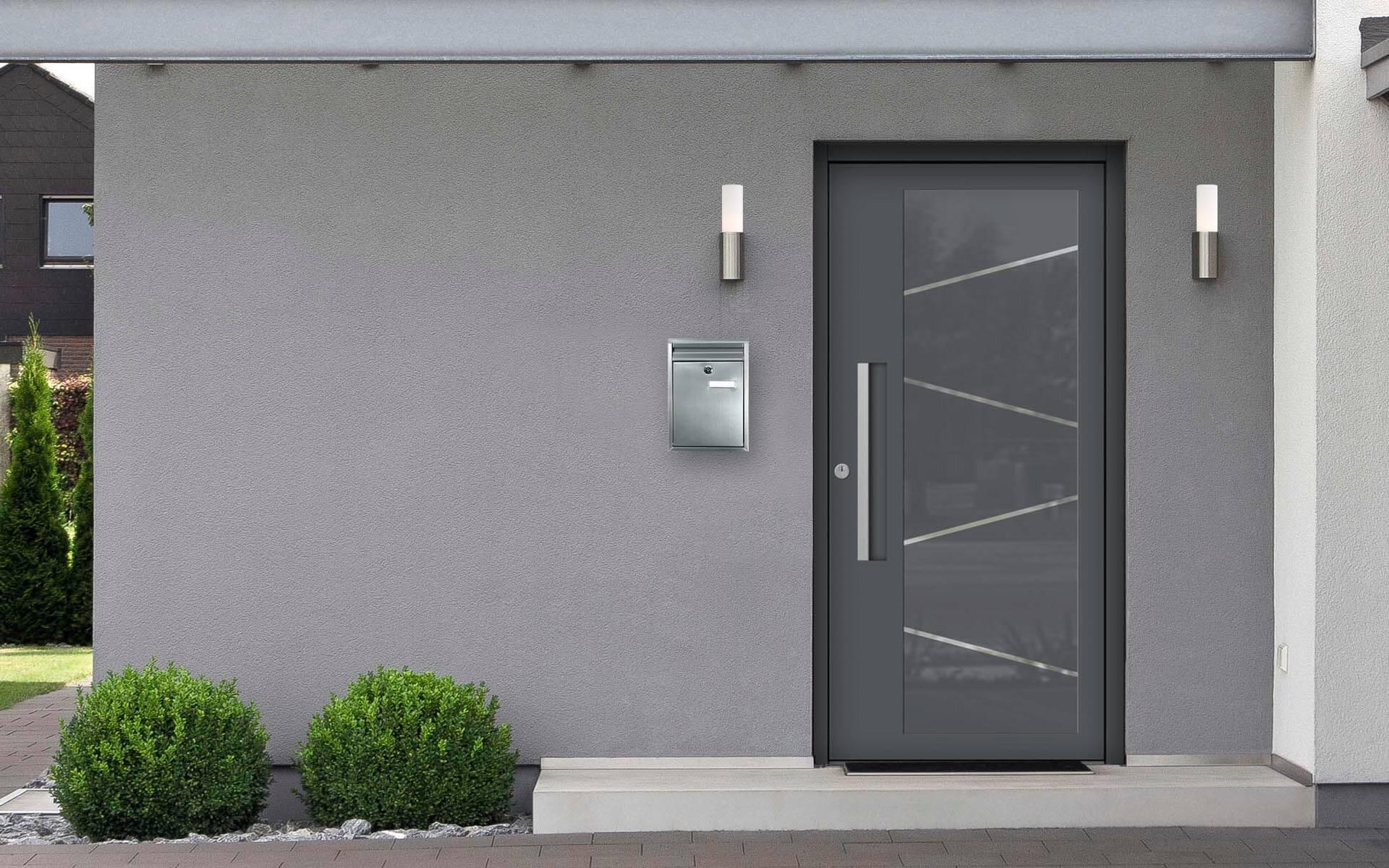 Hliníkové vchodové dvere s odolnou výplňou s dilatačným jadrom v grafitovej šedej farbe