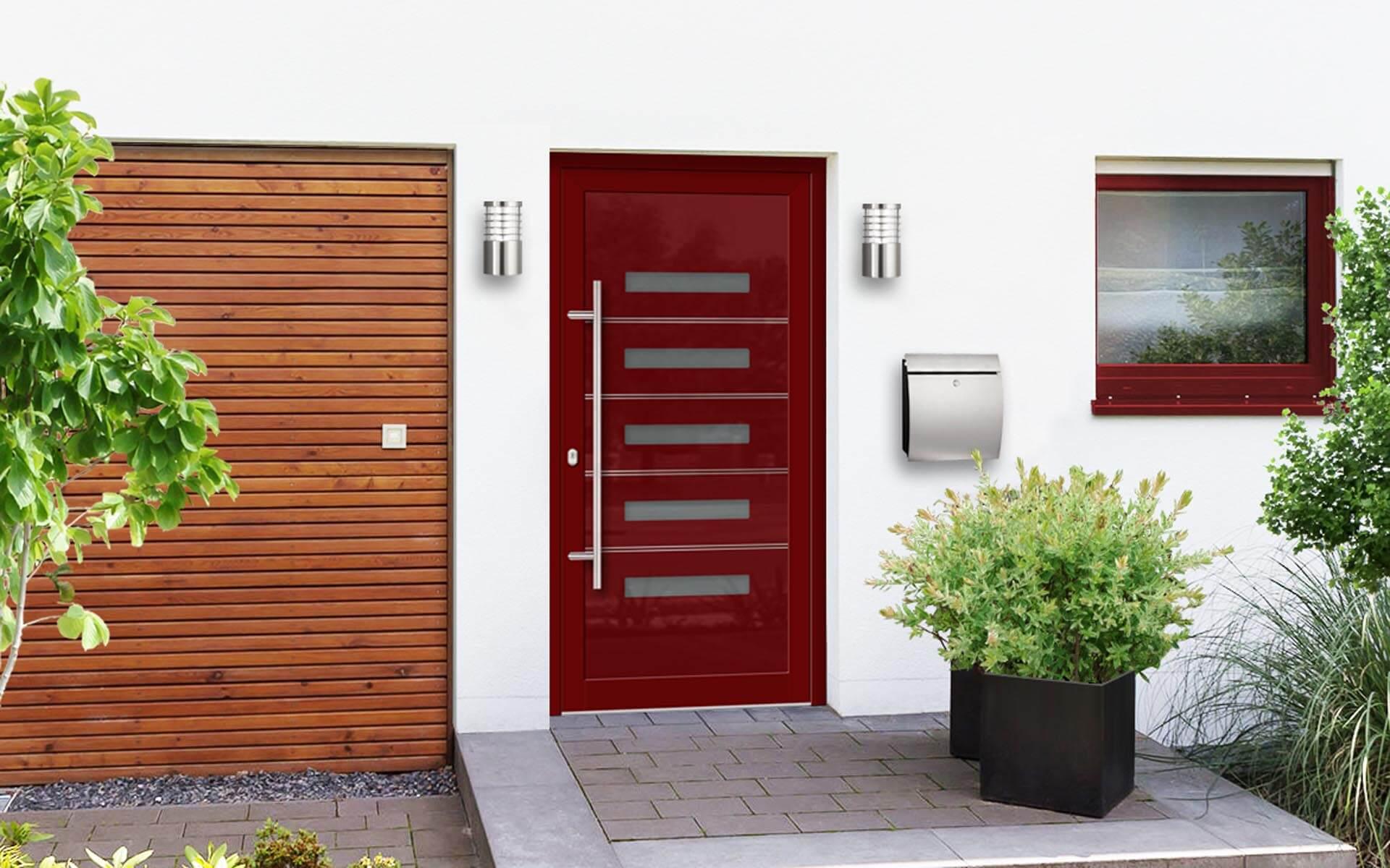 Vchodové hliníkové dvere do domu s odolnou výplňou s dilatačným jadrom EV-1003 iX vo farbe RAL 3004